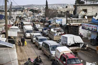 Civilians flee from Idlib toward the north to find safety inside Syria near the border with Turkey, Saturday, Feb. 15, 2020…