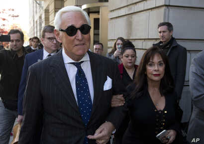 FILE - In this Nov. 15, 2019, file photo, Roger Stone, left, with his wife Nydia Stone, leaves federal court in Washington,…