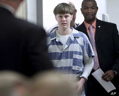 FILE - In this April 10, 2017, file photo, Dylann Roof enters the court room at the Charleston County Judicial Center to enter…