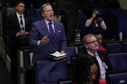 Former White House press secretary Sean Spicer and reporter for Newsmax, left, attends a coronavirus task force briefing at the…
