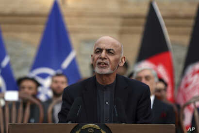 Afghan President Ashraf Ghani, speaks during a joint news conference in presidential palace in Kabul, Afghanistan, Saturday,…