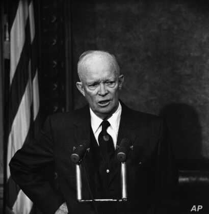 FILE - In this Dec. 10, 1958 file photo, President Dwight Eisenhower speaks during a news conference in Washington. A gay…