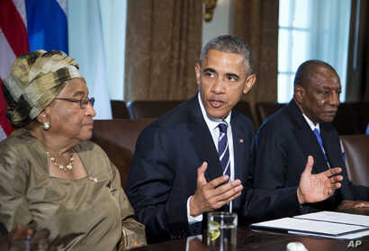President Barack Obama, flanked by Liberian President Ellen Johnson Sirleaf, left, and Guinean President Alpha Condé, speaks in…