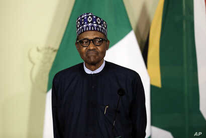 Nigerian President Muhammadu Buhari attends a press briefing after meeting with South African President Cyril Ramaphosa in…