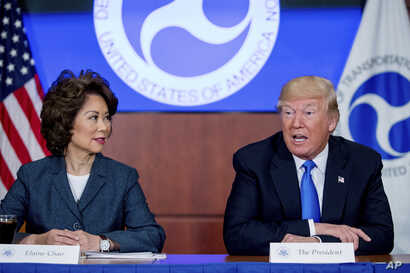 President Donald Trump, accompanied by Transportation Secretary Elaine Chao, left, speaks at a roundtable on infrastructure at…