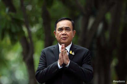 Thailand's Prime Minister Prayuth Chan-ocha gestures while speaking to media members at the Government House in Bangkok, June 6, 2019.