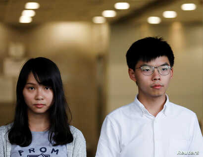 Pro-democracy activists Joshua Wong and Agnes Chow leave the Eastern Court after being released on bail in Hong Kong, China August 30, 2019. REUTERS/Anushree Fadnavis