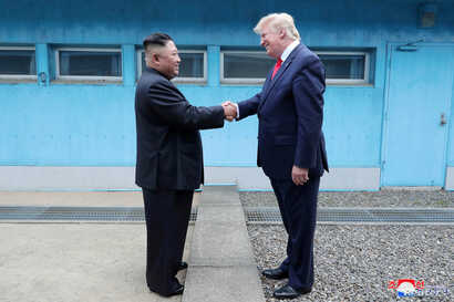FILE - U.S. President Donald Trump shakes hands with North Korean leader Kim Jong Un as they meet at the demilitarized zone separating the two Koreas, in Panmunjom, South Korea, June 30, 2019.