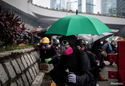 A demonstrator prepares to throw a brick at police during a protest in Hong Kong, China August 31, 2019. REUTERS/Danish Siddiqui