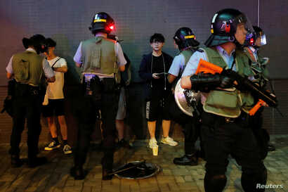 Riot police officers search people and their belongings, after an anti-extradition bill protest, at Po Lam Mass Transit Railway (MTR) station, in Hong Kong, China September 5, 2019. REUTERS/Tyrone Siu