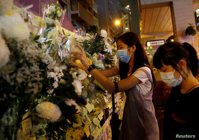 Women pay their respects to the protesters who were injured during clashes with the police by placing flowers outside Prince Edward station, in Hong Kong, China, September 4, 2019. REUTERS/Anushree Fadnavis