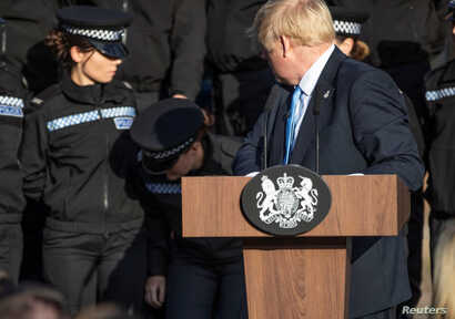 Britain's Prime Minister Boris Johnson reacts after student officer needed to sit down as he made a speech during a visit to West Yorkshire, Britain September 5, 2019.