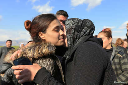 A relative kisses a Yazidi survivor woman following her release from Islamic State militants in Syria, in Duhok, Iraq, March 2, 2019. Picture taken March 2, 2019.  REUTERS/Ari Jalal