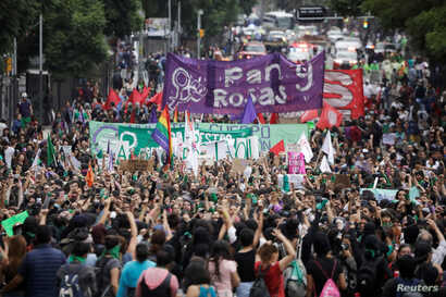 "Women take part in a protest, part of a movement known as ""Marea Verde"", to mark the International Safe Abortion Day in Mexico City, Mexico September 28, 2019. REUTERS/Luis Cortes"