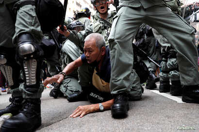 An anti-government protester is detained during a demonstration at Causeway Bay district in Hong Kong, China September 29, 2019.  REUTERS/Tyrone Siu