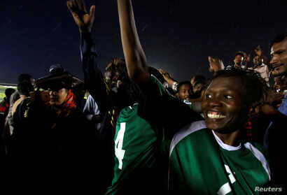 Players from Sudan's of Al-tahadi woman soccer team react after taking part in Sudan's first women's league soccer match at the…