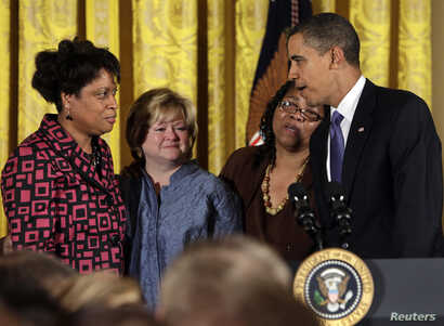U.S. President Barack Obama talks to James Byrd's sisters Louvon Harris (L) and Betty Byrd Baotner (2nd R) and Matthew Shepard…