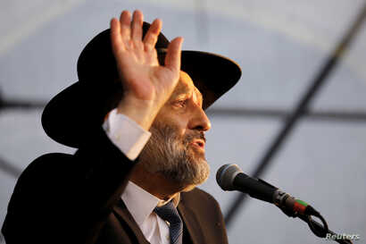 Israeli Interior Minister Aryeh Deri speaks during an annual pilgrimage to the gravesite of Moroccan-born sage and Jewish…