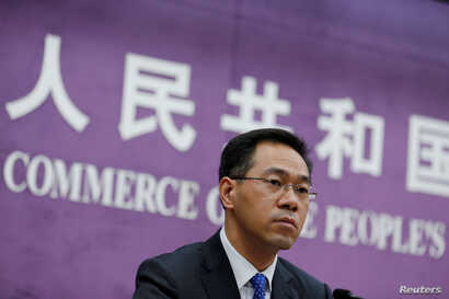 China's Ministry of Commerce spokesperson Gao Feng attends a news conference at the commerce ministry in Beijing, China, June…