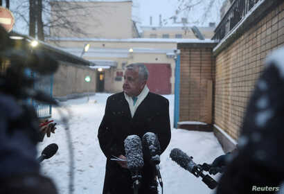 U.S. ambassador to Russia John Sullivan speaks with journalists after his meeting with Paul Whelan, a U.S. national arrested…