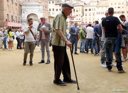 An elderly man walks in the old city centre of Siena, Italy June 30, 2017. REUTERS/Stefano Rellandini