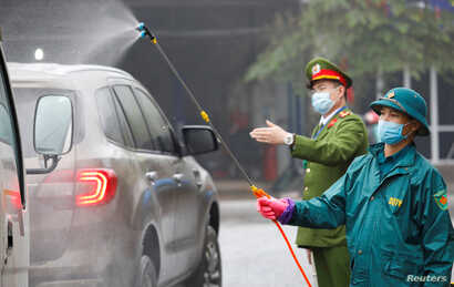 Members of anti-coronavirus team spray chemical into vehicles on a road in Thai Nguyen province, Vietnam February 7, 2020…