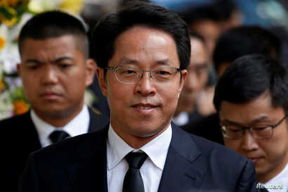 FILE PHOTO: Zhang Xiaoming, Director of China's Liaison Office in Hong Kong, attends the funeral of Cheng Yu-tung, founder of…