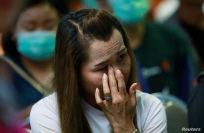 Supporters of Future Forward Party cries at the party's headquarters in Bangkok, Thailand February 21, 2020. REUTERS/Soe Zeya…