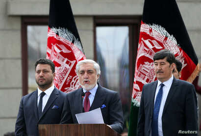 FILE PHOTO: Afghanistan's Abdullah Abdullah, accompanied by his Vice President Babur Farahmand (L) and his  Second Vice…