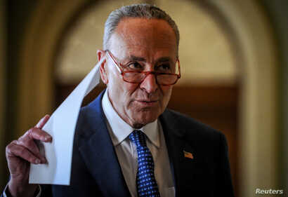 U.S. Senate Minority Leader Chuck Schumer (D-NY) makes a statement after meetings to wrap up work on coronavirus economic aid…