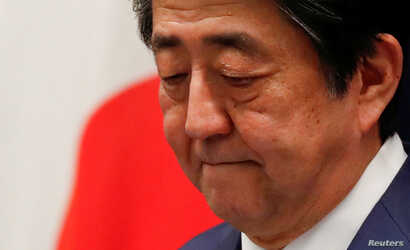 FILE PHOTO : Japan's Prime Minister Shinzo Abe attends a news conference on Japan's response to the coronavirus outbreak at his…