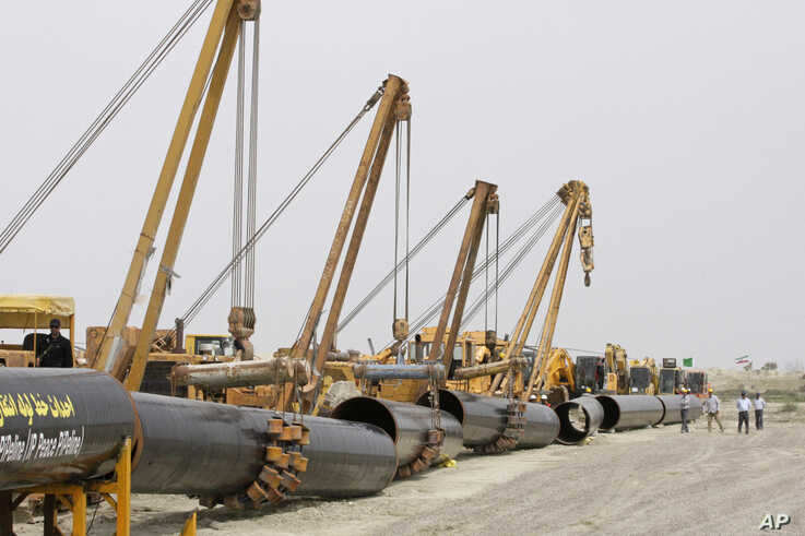 FILE - Sections of gas pipes are seen at the start of construction on a pipeline to transfer natural gas from Iran to Pakistan, in Chabahar, southeastern Iran, near the Pakistani border, March 11, 2013.