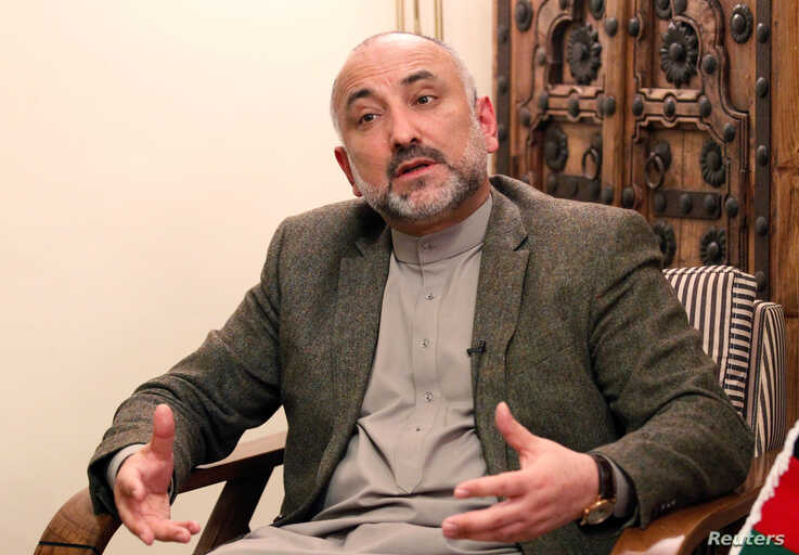 FILE - Mohammad Haneef Atmar, former national security adviser and candidate in the upcoming presidential election, speaks during an interview in Kabul, Afghanistan Feb. 23, 2019.
