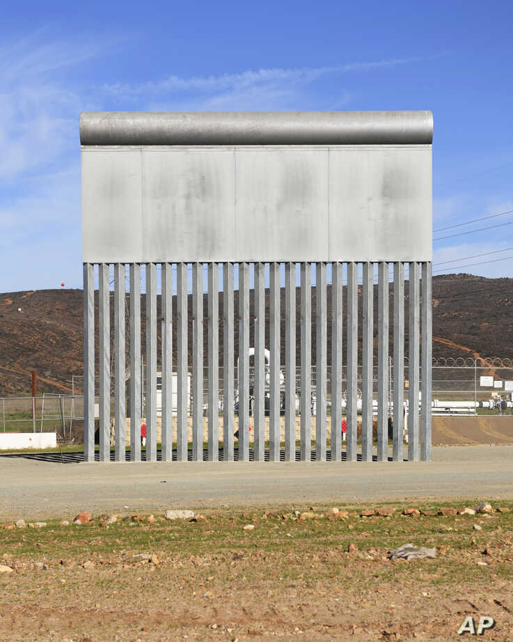 A border wall prototype stands in San Diego near the Mexico-U.S. border, seen from Tijuana, Mexico, Dec. 22, 2018.