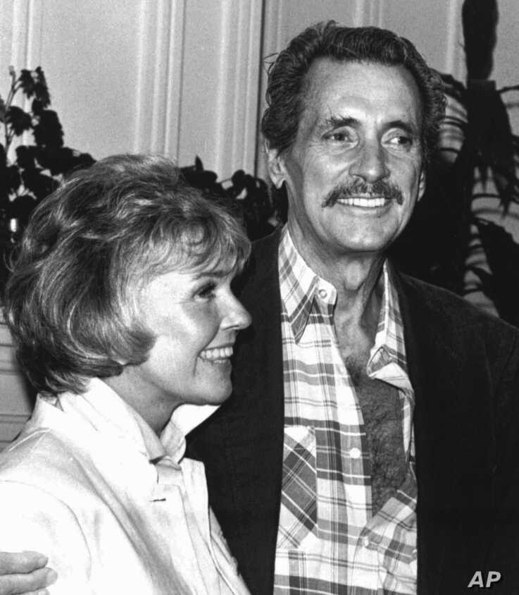 In this July 18,1985, file photo, Doris Day and Rock Hudson speak at a news conference in Monterey, Calif.