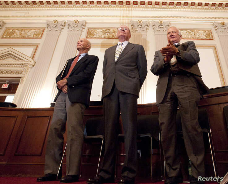 Apollo 11 astronauts Neil Armstrong, Michael Collins (L) and Buzz Aldrin (R) stand during a recognition ceremony at the U.S House of Representatives Committee on Science and Technology tribute to the Apollo 11 astronauts at the Cannon House Office Bu