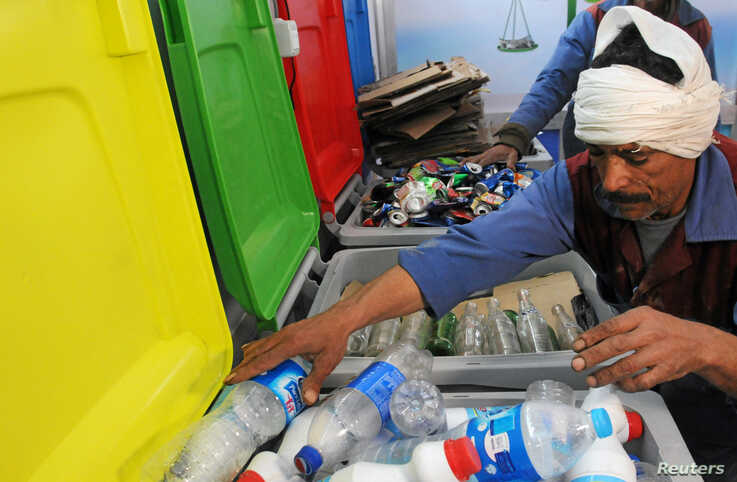A worker sorts through recycling bins at a center that offers residents money in exchange of their recyclable garbage in an attempt to keep the streets clean in Cairo, Egypt, March 11, 2017.