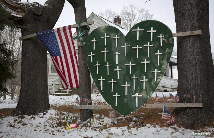 A heart is emblazoned with crosses to commemorate the 26 Sandy Hook Elementary School shooting victims in Sandy Hook village in Newtown, Connecticut, Dec. 13, 2013.