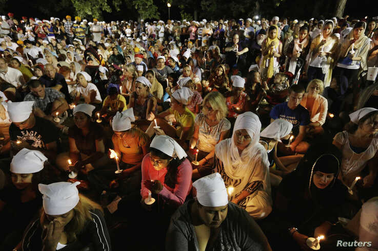 Sikhs and members of the community attend a vigil in Oak Creek, Wisconsin, Aug.7, 2012.