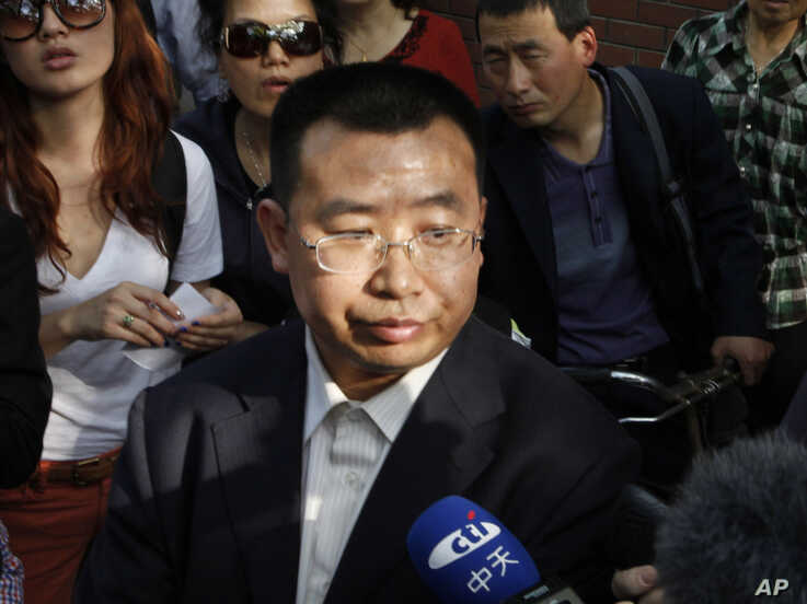 Human rights activist Jiang Tianyong speaks to journalists outside a hospital after his failed attempt to see blind Chinese activist Chen Guangcheng who is believed to be seeking treatment in Beijing, China, May 2, 2012.  The wife of one of China's ...