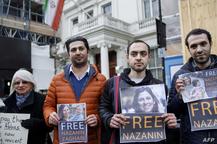 Campaigners hold posters of jailed British-Iranian woman Nazanin Zaghari-Ratcliffe at the Iranian Embassy in London on February 21, 2018.