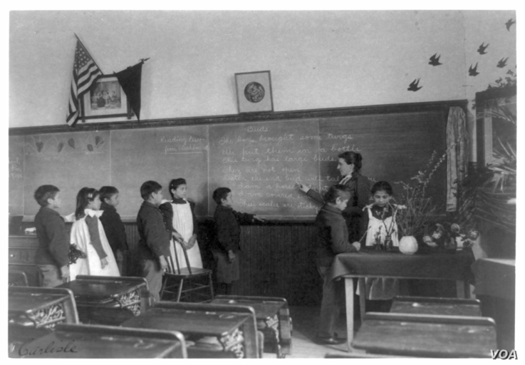Elementary school class of Indian students with botanical specimens at United States Indian School, Carlisle, Pennsylvania.  Photo by Francis Benjamin Johnson, Dec. 31, 1900