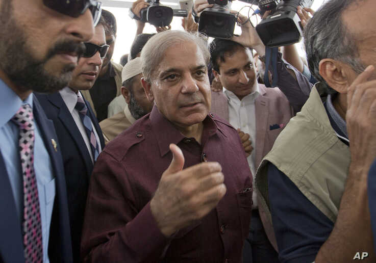 Pakistani opposition leader Shahbaz Sharif, center, who lost election for the premiership of Pakistan, arrives at the National Assembly in Islamabad, Pakistan, Aug. 17, 2018.