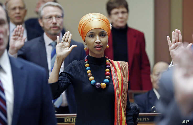 FILE - In this Jan. 3, 2017, file photo, State Rep. Ilhan Omar takes the oath of office as the 2017 Legislature convened in St. Paul, Minn. Omar is the nation's first Somali-American to be elected to a state legislature.