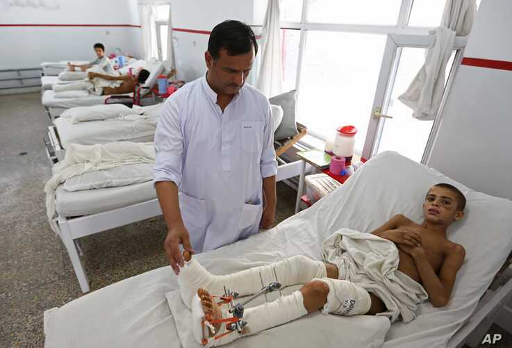 Afghan child war victims receive treatment at the Emergency Hospital in Kabul, Afghanistan, July 25, 2016. The United Nations mission in Afghanistan says the number of children killed or wounded in the country's conflict has surged in the first half