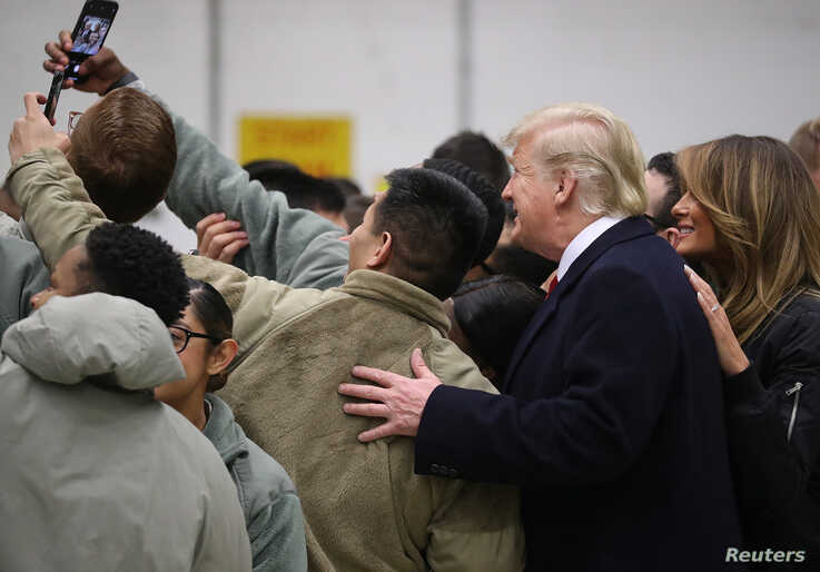 U.S. President Donald Trump and first lady Melania Trump take a selfie with U.S. troops at Ramstein Air Force Base, Germany, Dec. 27, 2018.