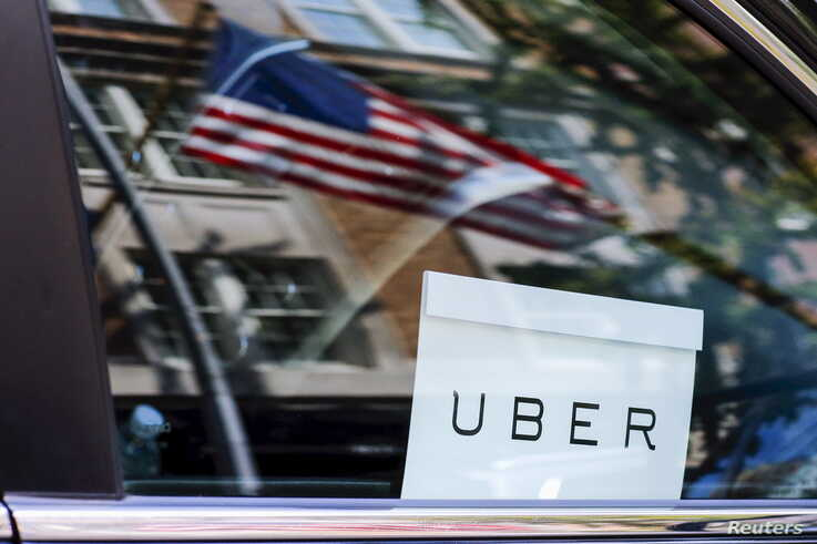 An Uber sign is seen in a car in New York, June 30, 2015.