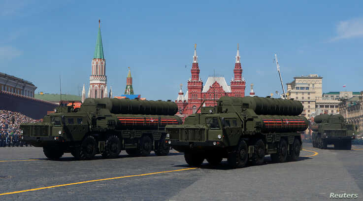 FILE - Russian servicemen drive S-400 missile air defense systems during the Victory Day parade in Moscow, May 9, 2018.