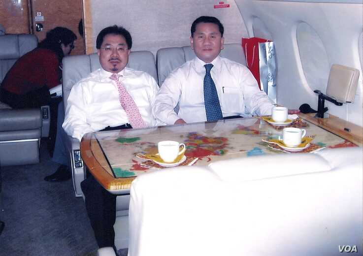 Former North Korean official, Ri Jong Ho, right, who oversaw North Korea's overall production and trade while serving at the Office 39 for decades, heads to Pyongyang with Chinese investment tycoon Sam Pa, December 2006.