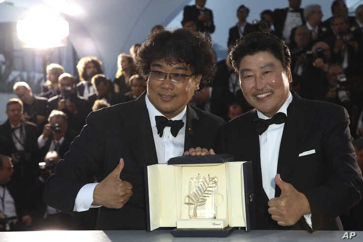 "Actor Kang-Ho Song, right, and director Bong Joon-ho pose with the Palme d'Or award for the film ""Parasite"" following the awards ceremony at the 72nd international film festival in Cannes, France, May 25, 2019."